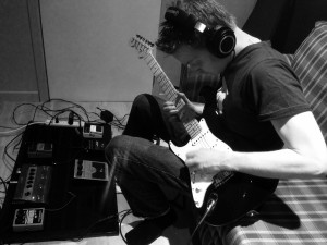 Mathieu recording his guitar tracks.